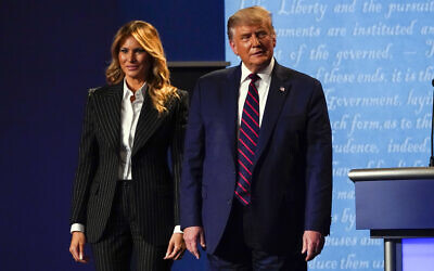 US President Donald Trump stands on stage with first lady Melania Trump after the first presidential debate with Democratic presidential candidate Joe Biden, September 29, 2020, at Case Western University and Cleveland Clinic, in Cleveland, Ohio. (AP Photo/Julio Cortez)