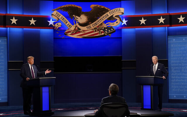 Moderator Chris Wallace of Fox News listens as US President Donald Trump and Democratic candidate Joe Biden participate in the first presidential debate September 29, 2020, at Case Western University and Cleveland Clinic, in Cleveland, Ohio. (AP Photo/Patrick Semansky)