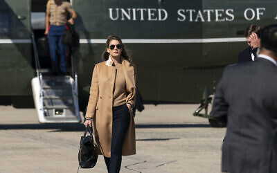 Counselor to the US President Hope Hicks walks from Marine One to accompany US President Donald Trump aboard Air Force One as he departs on September 30, 2020, at Andrews Air Force Base, Maryland. (AP Photo/Alex Brandon)