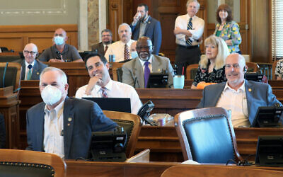 Republican members of the Kansas House, some wearing protective masks and some not, are seen at the Statehouse in Topeka, Kansas, June 4, 2020 (AP Photo/John Hanna, File)