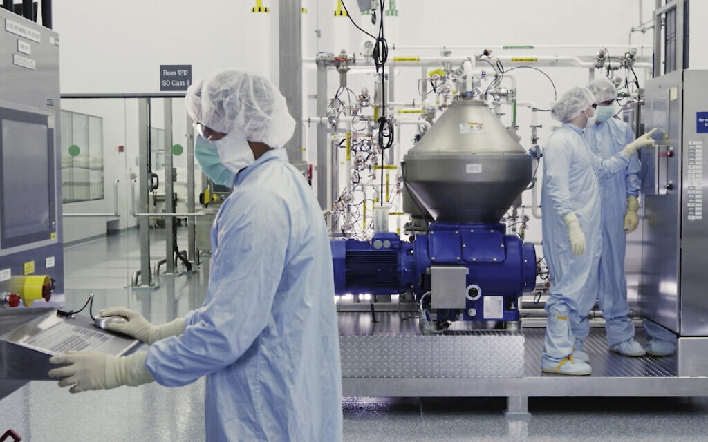 Illustrative: In this undated image from video provided by Regeneron Pharmaceuticals on Friday, October 2, 2020, scientists work with a bioreactor at a company facility in New York state, for efforts on an experimental coronavirus antibody drug. (Regeneron via AP)