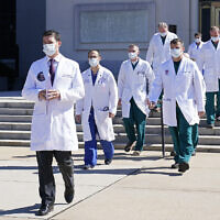 Dr. Sean Conley, physician to US President Donald Trump, is followed by a team of doctors for a briefing with reporters at Walter Reed National Military Medical Center in Bethesda, Maryland, October 3, 2020. (AP Photo/Susan Walsh)