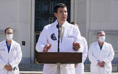 Dr. Sean Conley, physician to US President Donald Trump, briefs reporters at Walter Reed National Military Medical Center in Bethesda, Maryland, October 4, 2020. (AP Photo/Jacquelyn Martin)