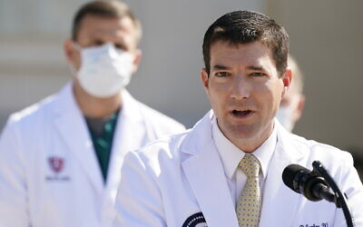 Dr. Sean Conley, physician to US President Donald Trump, briefs reporters at Walter Reed National Military Medical Center, in Bethesda, Maryland, October 4, 2020. (AP Photo/Jacquelyn Martin)