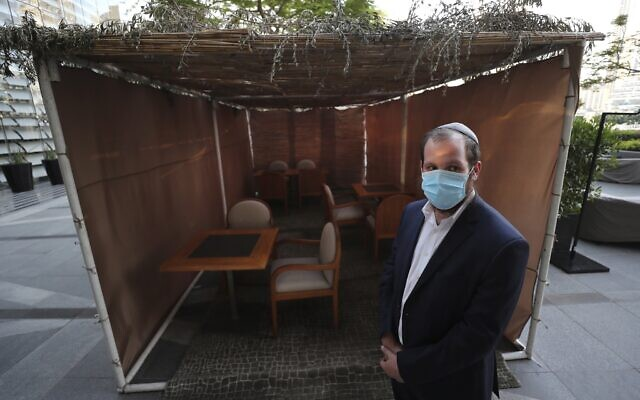 Rabbi Levi Duchman, in front of a sukkah set up at the KAF kosher restaurant in the Armani Hotel in Dubai, United Arab Emirates, on October 5, 2020. (AP/Kamran Jebreili)
