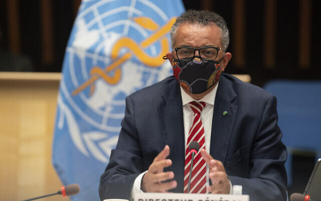In this photo released by the World Health Organization on October 5, 2020, WHO Director-General Dr. Tedros Adhanom Ghebreyesus wears a mask to protect against coronavirus, gestures during a special session on the COVID-19 response. (Christopher Black/WHO via AP)