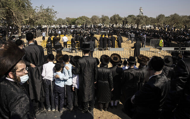Large numbers of ultra-Orthodox Jews gather for the funeral for Rabbi Mordechai Leifer, in Ashdod, Israel, Monday, Oct. 5, 2020. (AP Photo/Tsafrir Abayov)