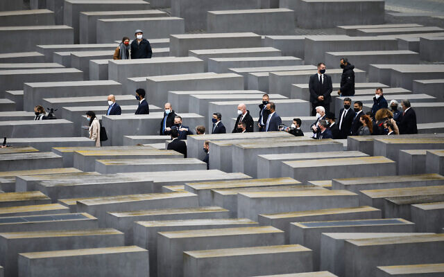 German Foreign Minister Heiko Maas, gestures at center, as he visits the Holocaust Memorial in Berlin with his counterparts from Israel Gabi Ashkenazi, below fourth right from center, and the United Arab Emirates Sheikh Abdullah bin Zayed Al Nahyan, second right from center, Tuesday, Oct. 6, 2020. The three foreign ministers met for talks in the German capital. (AP Photo/Markus Schreiber)