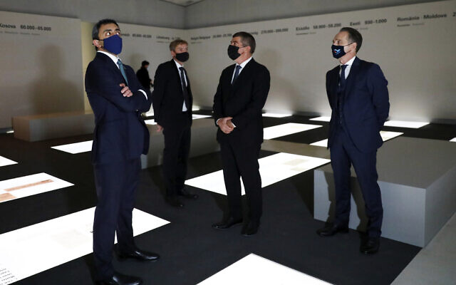 German Foreign Minister Heiko Maas, right, visits with his counterparts from Israel Gabi Ashkenazi, center, and the United Arab Emirates Sheikh Abdullah bin Zayed Al Nahyan, left, the exhibition hall at Holocaust Memorial during a meeting in Berlin, Germany, Tuesday, Oct. 6, 2020. (Michele Tantussi/Pool via AP)