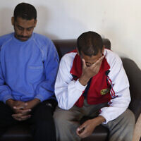 """In this March 30, 2019, file photo, Alexanda Amon Kotey, left, and El Shafee Elsheikh, who were allegedly among four British jihadis who made up a brutal Islamic State cell dubbed """"The Beatles,"""" speak during an interview with The Associated Press at a security center in Kobani, Syria.(AP Photo/Hussein Malla, File)"""