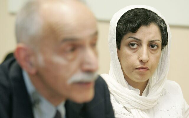 In this June 9, 2008 file photo, Iranian Narges Mohammadi, right, from the center for Human Rights Defenders, listens to Karim Lahidji, president of the Iranian league for the Defence of Human Rights, during a press conference on the Assessment of the Human Rights Situation in Iran, at the UN headquarters in Geneva, Switzerland. (AP/Keystone/Magali Girardin)