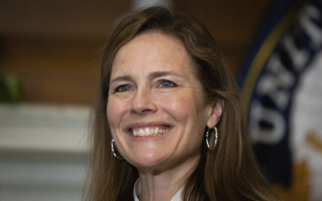 In this Oct. 1, 2020, photo, Supreme Court nominee Judge Amy Coney Barrett, meets with Sen. Roger Wicker, R-Miss., at the Capitol in Washington. Confirmation hearings begin Monday for President Donald Trump's Supreme Court nominee, Amy Coney Barrett. If confirmed, the 48-year-old appeals court judge would fill the seat of liberal Justice Ruth Bader Ginsburg, who died last month.  (Graeme Jennings/Pool via AP)