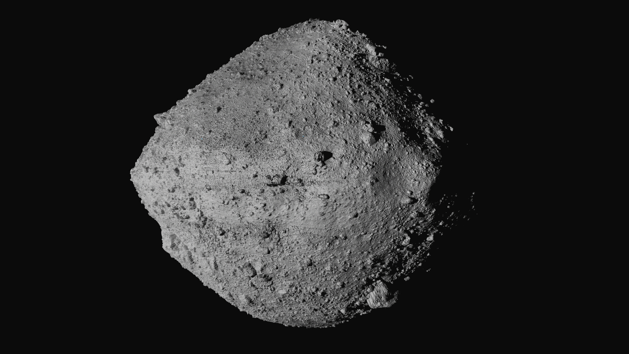 This undated image made available by NASA shows the asteroid Bennu from the OSIRIS-REx spacecraft. After almost two years circling the ancient asteroid OSIRIS-REx will attempt to descend to the treacherous boulder-packed surface and snatch a handful