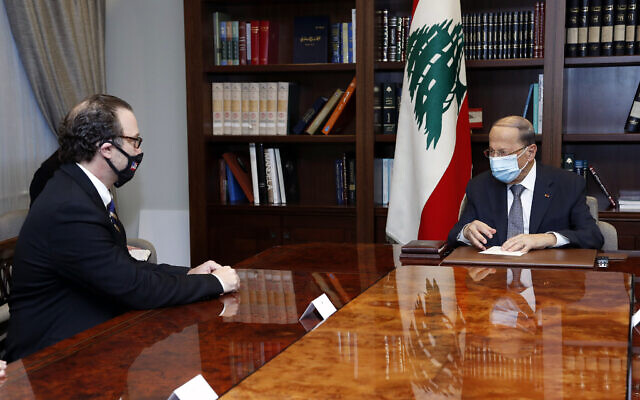 In this photo released by Lebanon's official government photographer Dalati Nohra, Lebanese President Michel Aoun, right, meets with US Assistant Secretary of State for Near Eastern Affairs David Schenker at the Presidential Palace in Baabda, east of Beirut, Lebanon, Friday, Oct. 16, 2020. (Dalati Nohra/Lebanese Government via AP)