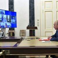 Russian President Vladimir Putin chairs a Security Council meeting via video conference in Moscow, Russia, Friday, Oct. 16, 2020. (Alexei Druzhinin, Sputnik, Kremlin Pool Photo via AP)