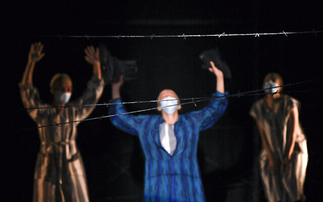 """Actresses of the Jewish State Theater, wearing face masks for protection against COVID-19 infection, perform during the rehearsals for the premiere of the """"The Beautiful Days of My Youth"""" play, based on the diary of Romanian Jewish Holocaust survivor Ana Novac, in Bucharest, October 15, 2020. (AP Photo/Andreea Alexandru)"""
