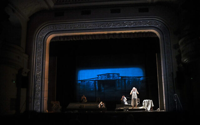 """Actresses of the Jewish State Theater, wearing face masks for protection against the COVID-19 infection, perform during the rehearsals for the premiere of the """"The Beautiful Days of My Youth"""" play, based on the diary of Romanian Jewish Holocaust survivor Ana Novac, in Bucharest, October 15, 2020. (AP Photo/Andreea Alexandru)"""
