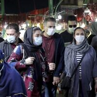 People wear protective face masks to help prevent the spread of the coronavirus, in the Tajrish traditional bazaar in northern Tehran, Iran, October 15, 2020. (AP Photo/Ebrahim Noroozi, File)