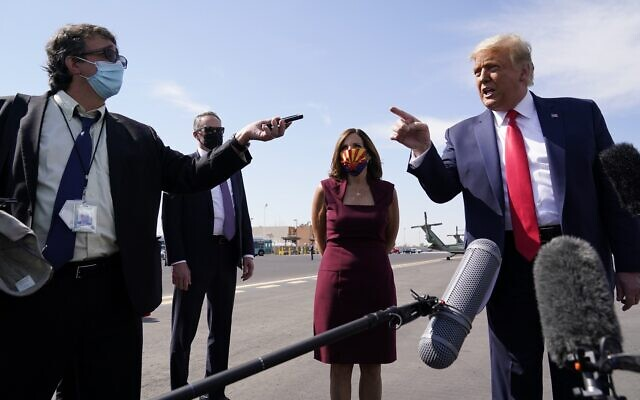 US President Donald Trump talks to reporters at Phoenix Sky Harbor International Airport, Monday, Oct. 19, 2020, in Phoenix (AP Photo/Alex Brandon)