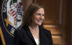 US Supreme Court nominee Amy Coney Barrett, meets with Sen. Martha McSally, R-Ariz., Wednesday, Oct. 21, 2020, on Capitol Hill in Washington. (Greg Nash/Pool via AP)