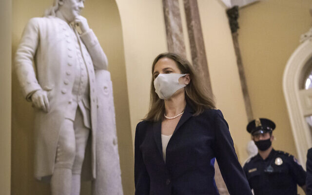 Judge Amy Coney Barrett, US President Donald Trump's nominee for the Supreme Court, arrives for closed meetings with senators, at the Capitol in Washington, October 21, 2020. (AP Photo/J. Scott Applewhite)