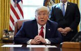 US President Donald Trump speaks while on a phone call with leaders of Sudan and Israel in the Oval Office of the White House, Friday, Oct. 23, 2020, in Washington. (AP Photo/Alex Brandon)