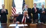 US President Donald Trump talks on a phone call with the leaders of Sudan and Israel, as Treasury Secretary Steven Mnuchin, left, Secretary of State Mike Pompeo, White House senior adviser Jared Kushner, and National Security Adviser Robert O'Brien, applaud in the Oval Office of the White House, Oct. 23, 2020, in Washington. (AP/Alex Brandon)