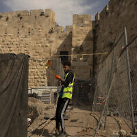 A worker at a construction site inside the Tower of David Museum in the Old City of Jerusalem, October 28, 2020. (AP Photo/Maya Alleruzzo)