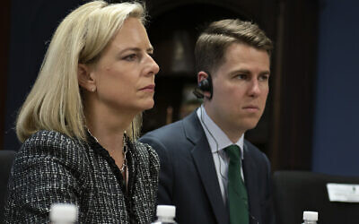 "This March 27, 2018, provided by the Department of Homeland Security, then-Secretary of Homeland Security Kirstjen Nielsen and then-Department of Homeland Security chief of staff Miles Taylor, right, meet with Honduran President Juan Hernandez, not pictured, and security ministers from the Northern Triangle countries in Tegucigalpa, Honduras. Taylor, a former Trump administration official who penned a scathing anti-Trump op-ed and book under the pen name ""Anonymous"" made his identify public Wednesday, Oct. 28, 2020. (Tim Godbee/Department of Homeland Security via AP)"