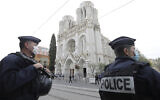 Police officers stand guard near Notre Dame church in Nice, southern France, October 29, 2020. (Eric Gaillard/Pool via AP)
