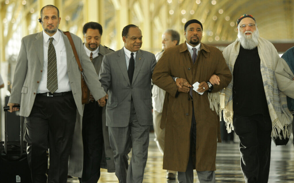 From left are, Imam Omar Shahin; Ibrahim Ramey, Director of Civil and Human Rights with the Muslim American Society; Rev. Walter E. Fauntroy, with the National Black Leadership Roundtable; Mahdi Bray, Director of the Muslim American Society; and Rabbi Arthur Waskow, of the Shalom Center in Philadelphia walk at Washington's Ronald Reagan National Airport, Monday, Nov. 27, 2006. (AP Photo/Lawrence Jackson)