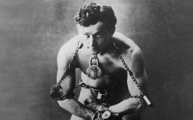Legendary escape artist Harry Houdini is shown in chains in this photo circa 1899 (AP Photo, File)