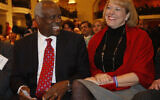 In this Nov. 15, 2007, photo, US Supreme Court Justice Clarence Thomas, left, sits with his wife Virginia Thomas, as he is introduced at the Federalist Society in Washington(AP Photo/Charles Dharapak, File)