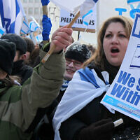 FILE -- People at a pro-Israel demonstration in Frankfurt, Germany, on Jan. 11, 2009. (AP Photo/Daniel Roland)