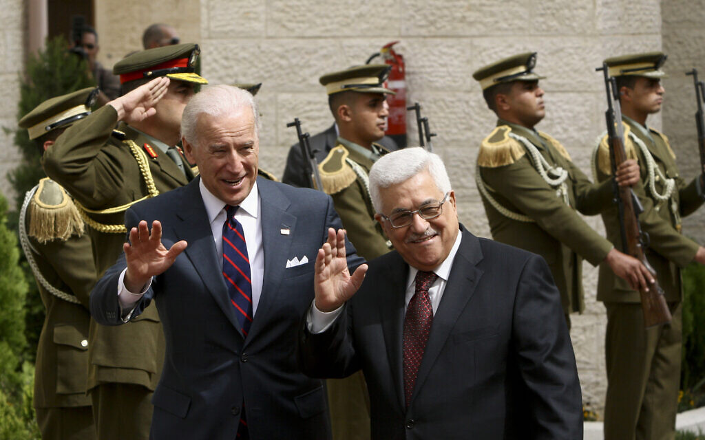 US Vice President Joseph Biden, left, and Palestinian Authority President Mahmoud Abbas wave to the press ahead of their meeting in the West Bank city of Ramallah, March 10, 2010. (AP Photo/Tara Todras-Whitehill)