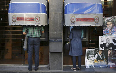 Iranians use ATMs of Bank Melli Iran in downtown Tehran, Iran, April 4, 2015. (AP Photo/Vahid Salemi, File)