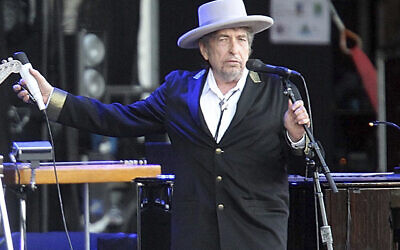"""This July 22, 2012 file photo shows US singer-songwriter Bob Dylan performing on stage at """"Les Vieilles Charrues"""" Festival in Carhaix, western France.(AP Photo/David Vincent)"""