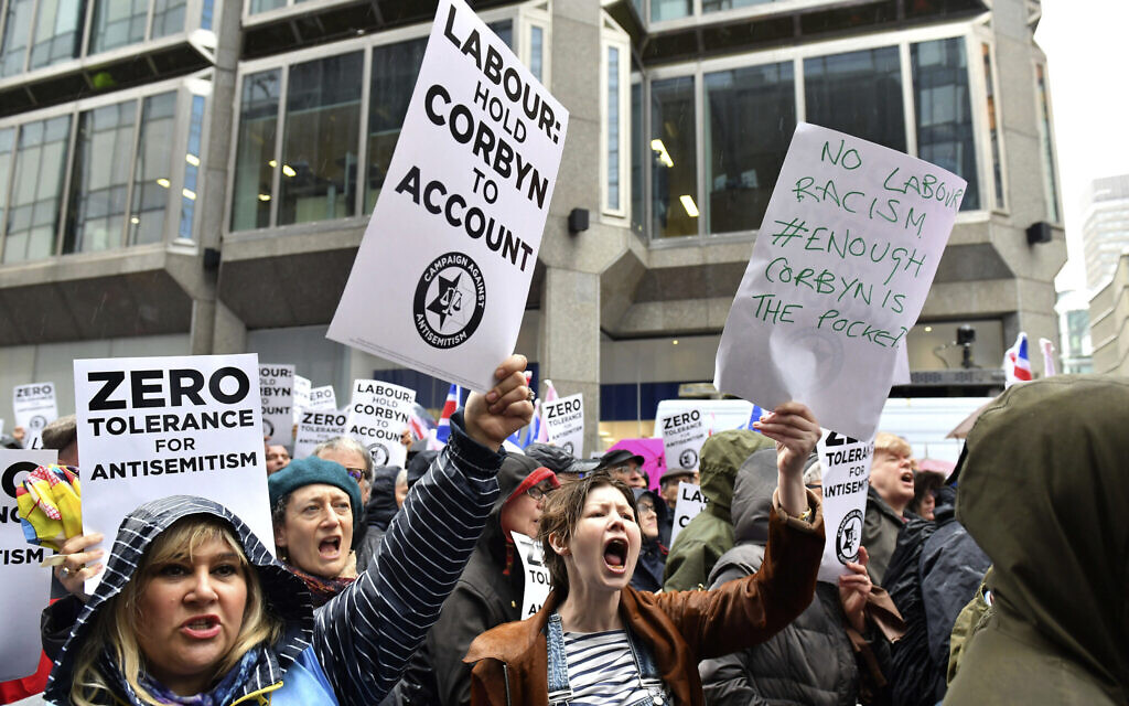 Illustrative: Protesters chant slogans during a demonstration organized by the Campaign Against Antisemitism against alleged prejudice in the Labour Party, amid a row over the party's handling of claims of anti-Semitism, outside the Labour Party headquarters, in London,  Sunday April 8, 2018. (Dominic Lipinski/PA via AP)