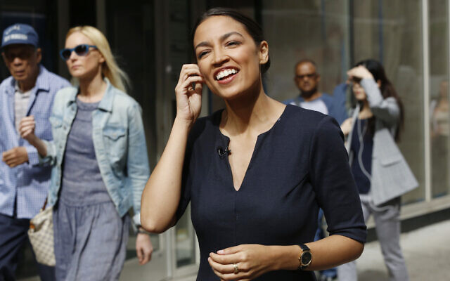 Alexandria Ocasio-Cortez, the winner of a Democratic Congressional primary in New York, talks to the media, June 27, 2018, in New York. Ocasio-Cortez, 28, upset U.S. Rep. Joe Crowley in the election. (AP Photo/Mark Lennihan)