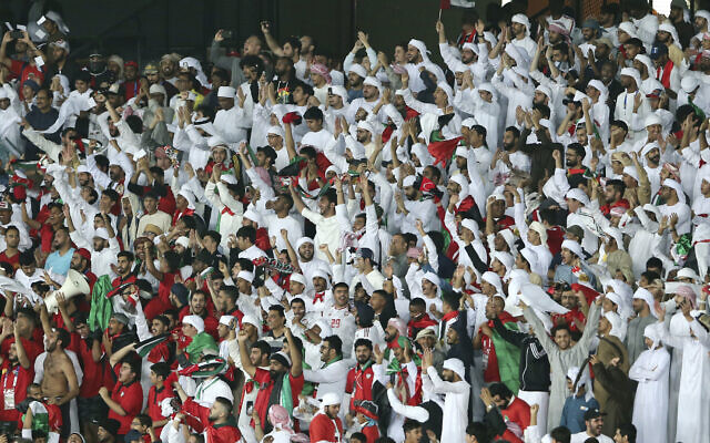 United Arab Emirates fans cheer for the team during the AFC Asian Cup group A soccer match between United Arab Emirates and India at Zayed Sports City Stadium in Abu Dhabi, United Arab Emirates, Jan. 10, 2019. (AP Photo/Kamran Jebreili)