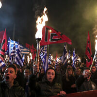 Supporters of Greece's extreme right Golden Dawn raise torches during a rally in Athens, on Feb. 2, 2019  (AP Photo/Yorgos Karahalis)