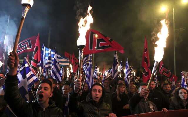 Supporters of Greece's extreme right Golden Dawn raise torches during a rally in Athens, on February 2, 2019  (AP Photo/Yorgos Karahalis)