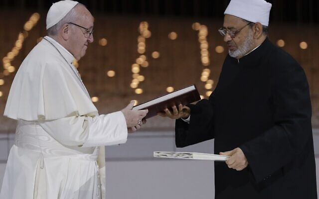 """Illustrative: Pope Francis, left, and Sheikh Ahmed el-Tayeb, the grand imam of Egypt's Al-Azhar, exchange a joint statement on """"human fraternity"""" after an interfaith meeting at the Founder's Memorial in Abu Dhabi, United Arab Emirates, Monday, Feb. 4, 2019. (AP Photo/Andrew Medichini)"""