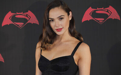 "In this Saturday, March 19, 2016 photo, Israeli actress Gal Gadot poses for photos during a press conference to promote the movie: ""Batman v Superman: Dawn of Justice"" in Mexico City.  (AP Photo/Marco Ugarte)"