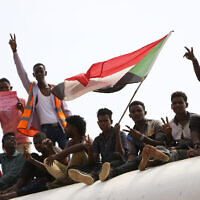 Sudanese pro-democracy supporters celebrate a final power-sharing agreement with the ruling military council August 17, 2019, in the capital, Khartoum. (AP)