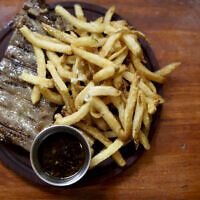"Illustrative: A vegan steak with fries at ""La Reverde"" vegan restaurant in Buenos Aires, Argentina on June 30, 2019. (AP Photo/Natacha Pisarenko)"