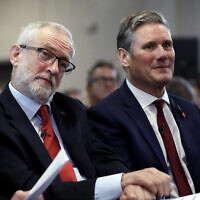 Britain's opposition Labour party leader Jeremy Corbyn, left, sits waiting to speak next to Keir Starmer Labour's Shadow Secretary of State for Exiting the European Union during their election campaign event on Brexit in Harlow, England, November 5, 2019. (AP Photo/Matt Dunham)