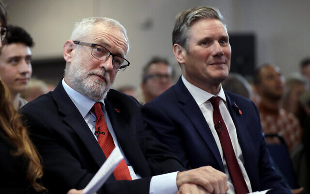 Jeremy Corbyn, left, sits waiting to speak next to Keir Starmer during their election campaign event on Brexit in Harlow, England, November 5, 2019. (AP Photo/Matt Dunham)