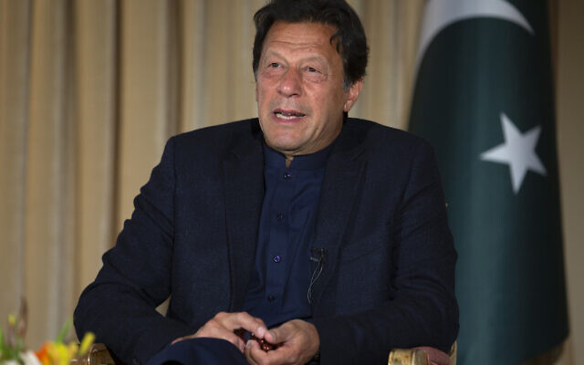 Pakistan's Prime Minister Imran Khan speaks to The Associated Press, in Islamabad, Pakistan, Monday, March 16, 2020.  (AP Photo/B.K. Bangash)