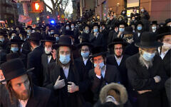 Illustrative: Hundreds of mourners gather in the Brooklyn borough of New York, Tuesday, April 28, 2020, to observe a funeral for Rabbi Chaim Mertz, a Hasidic Orthodox leader whose death was reportedly tied to the coronavirus. (Peter Gerber via AP)